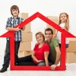 Stock Photo: Family in their new home concept