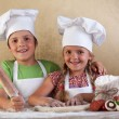 Happy kids making pizza togheter - Stock Photo