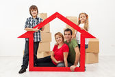 Family in their new home concept — Stock Photo