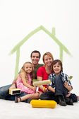 Family with two kids repainting their home — Stock Photo
