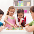 Foto Stock: Children playing board game