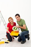 Young couple painting their home — Stock Photo