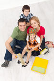 Family with paint preparing to redecorate their home — Stock Photo