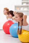 Happy healthy kids exercising — Stock Photo