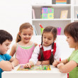 Kids playing board game in their room — Stok fotoğraf