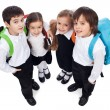 Happy school kids with back packs - Stock Photo