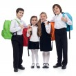 Happy elementary school kids with colorful back packs — Stock Photo