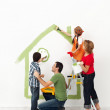 Happy family painting their home together — Stock Photo