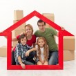 Stock Photo: Happy family in their new home