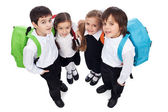 Happy school kids with back packs — Stock Photo