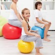 Happy family exercising at home — Stock Photo