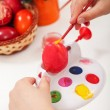 Stock Photo: Painting the easter eggs