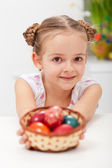 Girl with basket full of easter eggs — Stock Photo