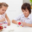 Children painting easter eggs — Stock Photo