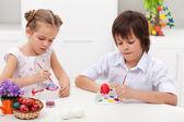 Children painting easter eggs — Stock Photo