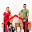 Family with kids buying a new home - Stock Photo