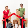 Family with kids buying a new home — Stock Photo