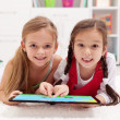 Little girls using tablet computer as artboard — Stock Photo