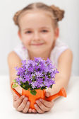Happy child with spring flowers — Stock Photo
