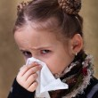 Little girl in flu season - blowing nose — Stock Photo