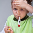 Sick little girl with pills and thermometer — Stock Photo