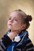 Little girl with sore throat in flu season — Stock Photo