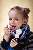 Little girl taking cough medicine syrup — Stock Photo