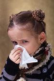 Little girl in flu season - blowing nose — Stock Photo
