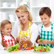 Salad time with the kids — Stock Photo