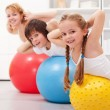 Kids exercising with their mother — Stock Photo #23486915