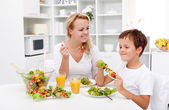 Woman and little boy having a healthy snack — Stock Photo