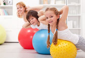 Kids exercising with their mother — Stock Photo