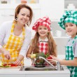 Kids helping mother in the kitchen — Stock Photo