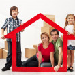 Happy family with kids moving into their new home — Stock Photo
