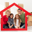 Family with kids in their new home — Stock Photo