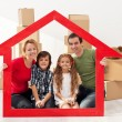 Family with kids in their new home — Stock Photo #25144679