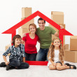 Happy family with kids moving into a new home — Stock Photo