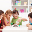 Foto Stock: Kids observing a science lab project at home
