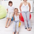 Womand kids exercising at home — Stock Photo #25144835