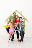 Happy family redecorating their home — Stock Photo
