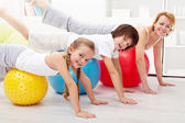 Healthy doing balancing exercise at home — Stock Photo