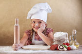 Little girl making pizza — Stock Photo