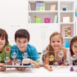 Happy kids connecting to social networks — Stock Photo