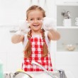 Happy little girl washing the dishes — Stock Photo #26881881