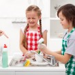 Do the dishes - kids ordered to help in the kitchen — Stock Photo #26882959