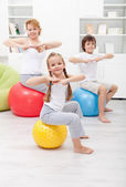 Gymnastic exercise with the kids — Stock Photo