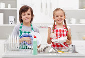 Happy kids helping in the kitchen — Stock Photo