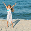 Stock Photo: Happy summer jump by the sea on the beach