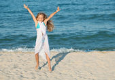Happy summer jump by the sea on the beach — Stock Photo