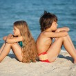 Kids relaxing on the beach — Stock Photo